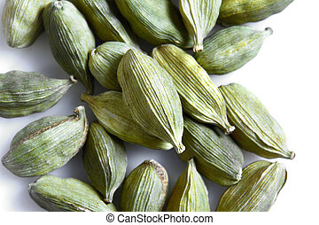 Green cardamom seeds isolated on white background. Top view. Close-up
