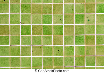 Green ceramic tile wall background.