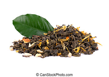 Green Ceylon tea with dry flowers and candied orange, isolated on white background. Close up.