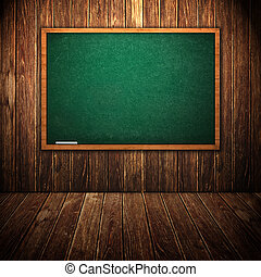 Green chalkboard in wooden interior
