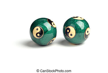 Green Chinese balls for relaxation on the white