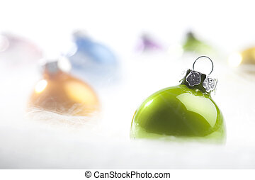 Green Christmas bauble in decorative snow