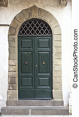 green classic door in Lucca, tuscany Italy medioeval town