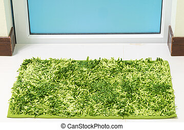 Green cleaning feet doormat or carpet in front of toilet ...