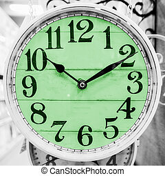 Green clock in a classical style. - Detail of green clock in...