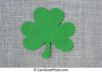 Green Clover on Burlap Background