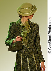 Green coat and a hat