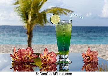 Green cocktail in a beach