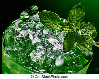 Green cocktail on dark background. - Green drink with ...