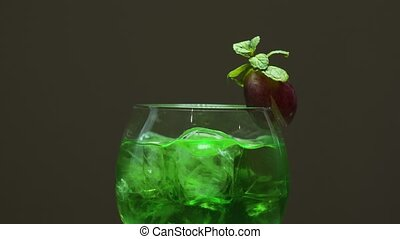 Green cocktail with grapes