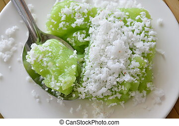 green coconut sweet pudding on spoon