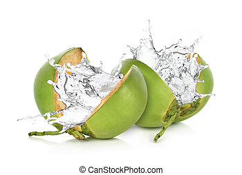Green coconut with water splash isolated on white background.