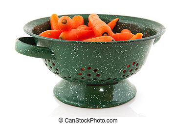 Green colander with fresh carrots