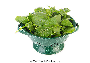 Green colander with spinach