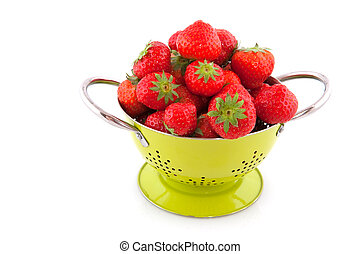 colander with strawberries