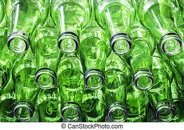 Closeup stack of green color bottles background