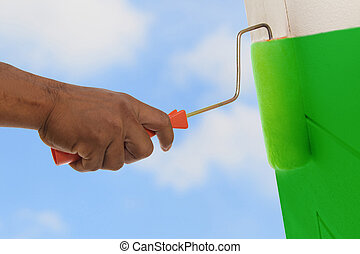 Green color painting wall with roller