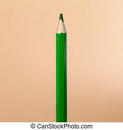 green coloured pencil on beige background