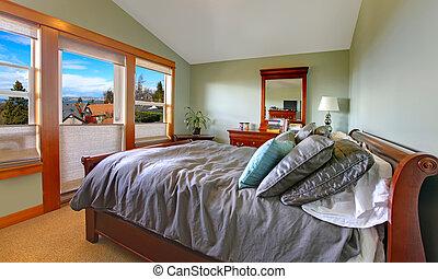 Green comfortable bedroom