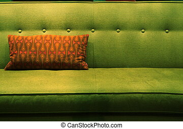 green couch orange pillow