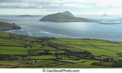 Green countryside by the coast with steep islands - Wide...