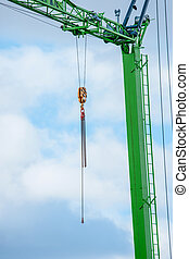 Green crane with a chain
