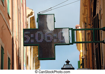 Green Cross Pharmacy Sign - Neon Pharmacy Sign with the Time...