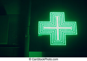 Green Cross Sign on a Building of Pharmacy