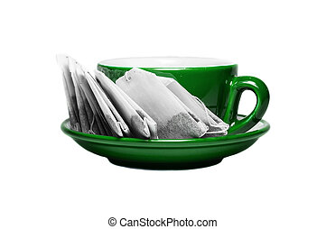 Green cup and plate with teabags
