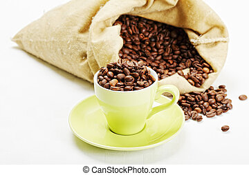 Green cup with coffee beens