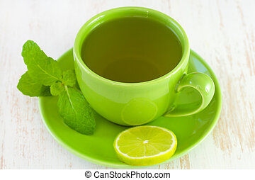green cup with tea