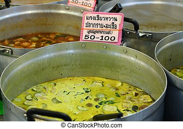 Green Curry - Thai green curry selling in the big pot in the...