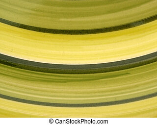 green curves - macro of green stripes on a plate