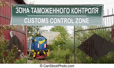 Green customs control zone signboard. Abandoned railway...