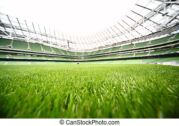 green-cut grass in large stadium at summer day, large soccer...