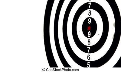 Green dart hitting the bullseye