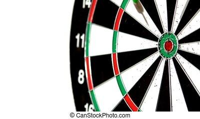 Green dart missing the bullseye on white background in slow...