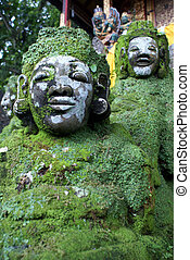 Green demons on the staircase in temple, Bali