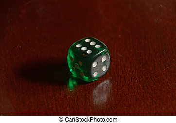Green die shows result of six