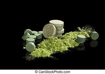 Green dietary supplements. Pills, ground powder,...