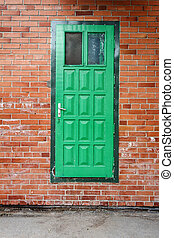 Green door on a red brick wall