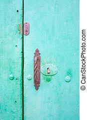 Green door with old locks