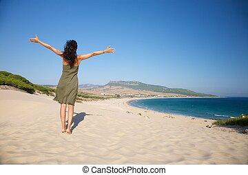 green dress woman at Bolonia beach