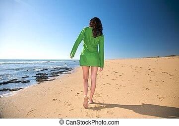 green dress woman walking