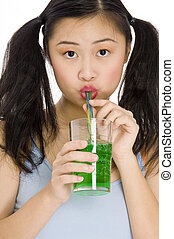 Green Drink - A pretty young asian woman drinking a green ...