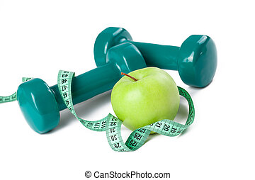 green dumbell with measuring tape and green apple