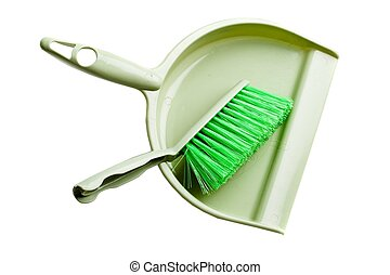 Green dust pan with brush on a white background