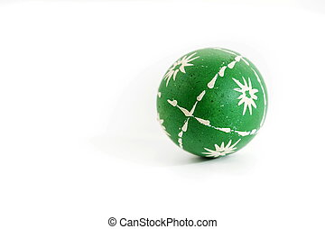 Green Easter wax decorated egg isolated on white background