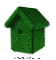 Green ecologic birdhouse covered with grass