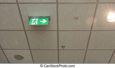 Green emergency exit sign. - Standard international symbol...